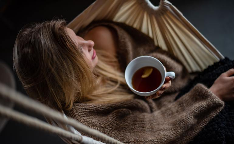 Girl with tea in hammock