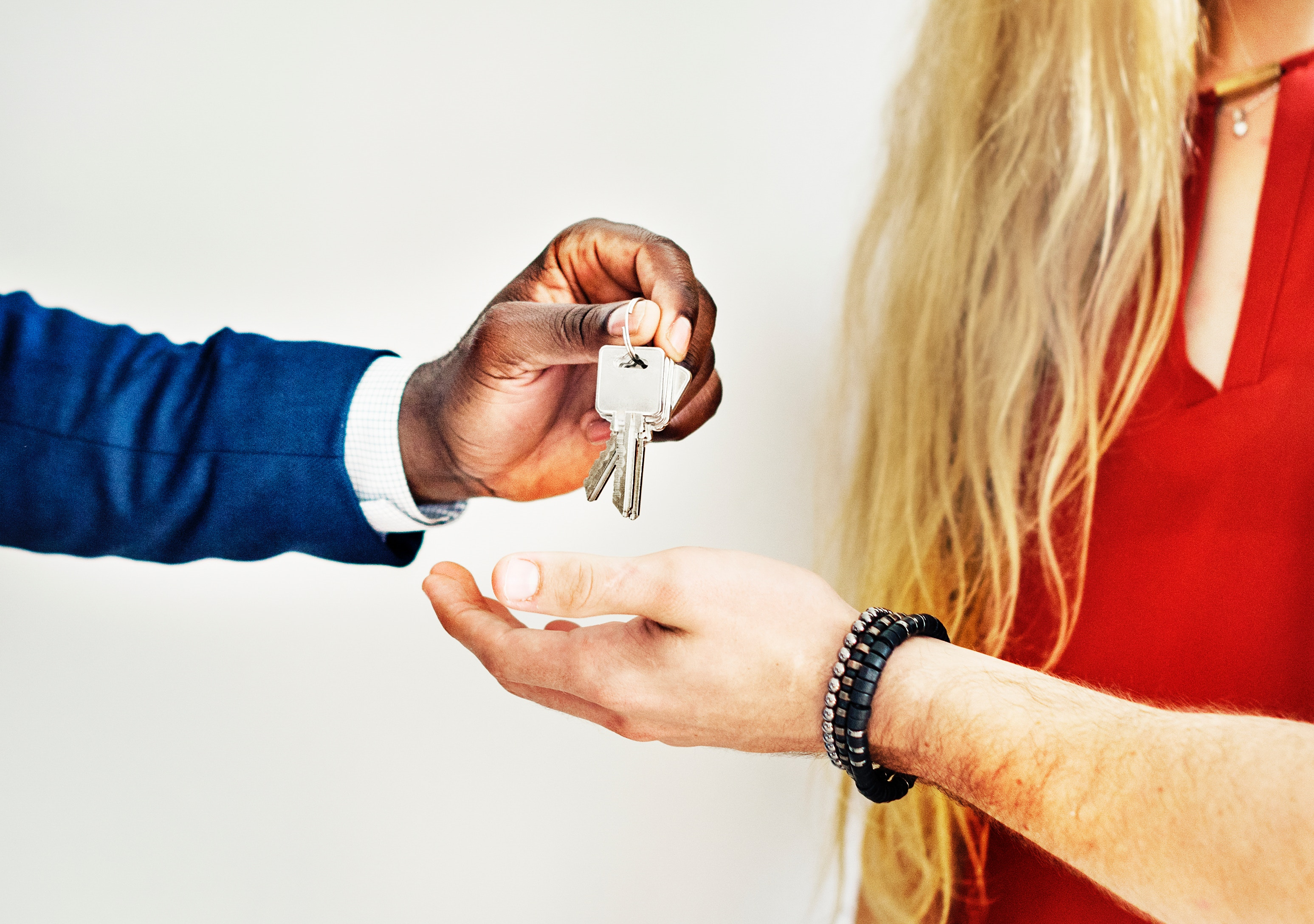 realtor giving keys to owner