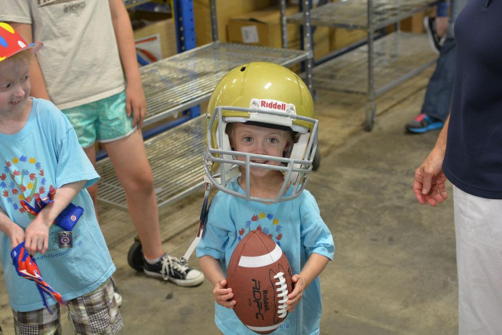 Bennett wearing a football helmet