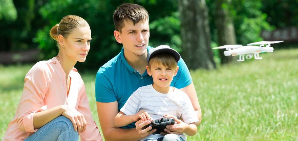 A family playing with a drone