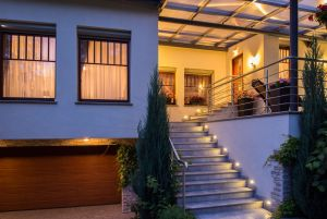 51795534 - modern stylish house with lighted outside stairs