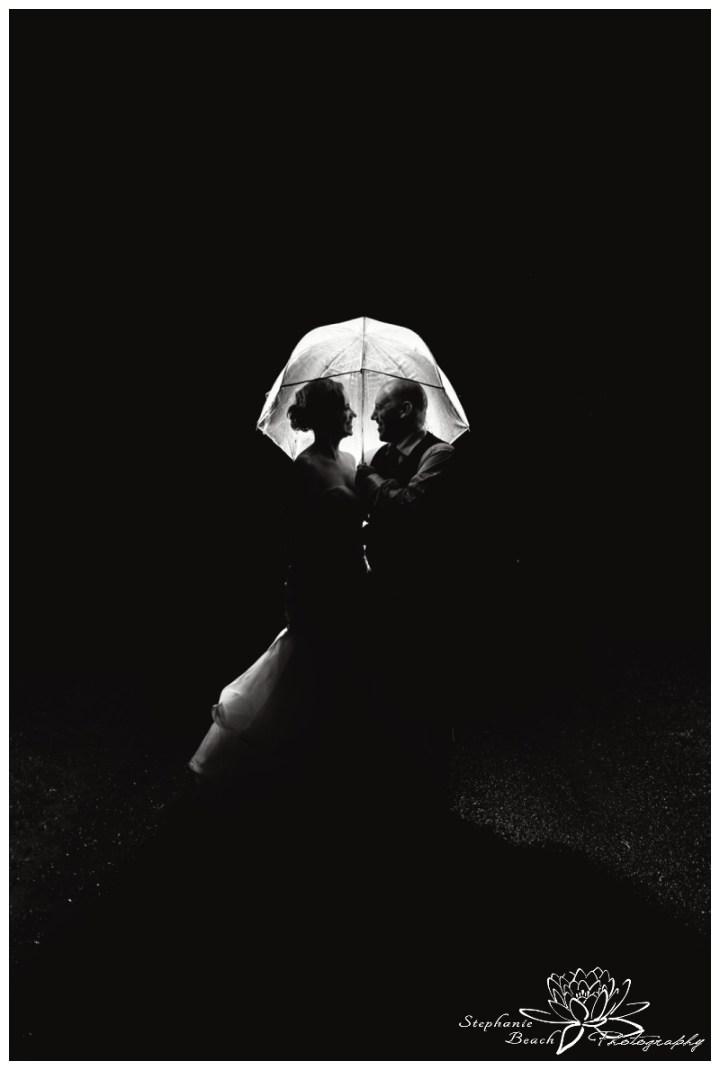 Jabulani-Vineyard-Wedding-Stephanie-Beach-Photography-night-rain-umbrella-bride-groom