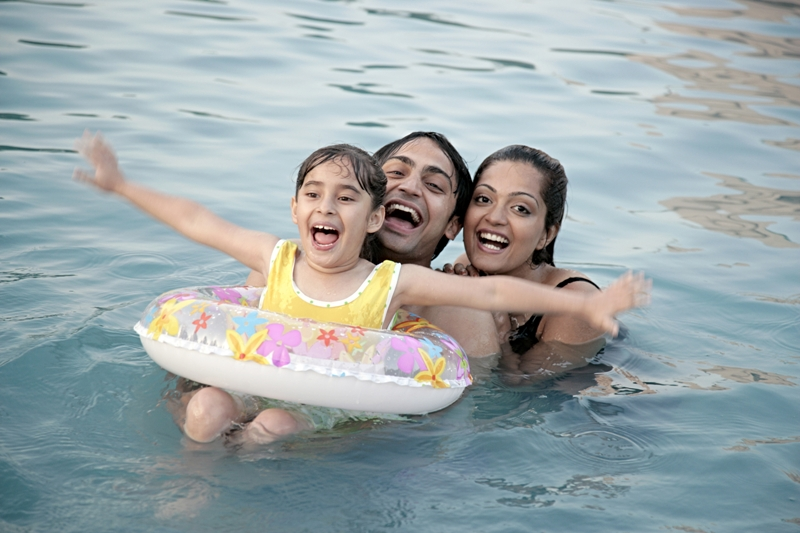 summer travel - Family playing in swimming pool