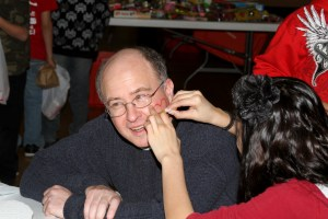 Fr. Steve, getting a heart face painted on his face!