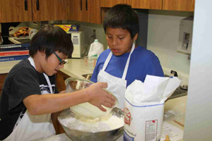 The Native American children at St. Joseph's Indian School learn life skills like cooking.