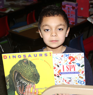 Our youngest Lakota students received new books from a generous donor.