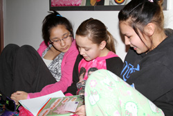 The older Lakota students enjoy reading to younger children on Dr. Seuss' birthday.