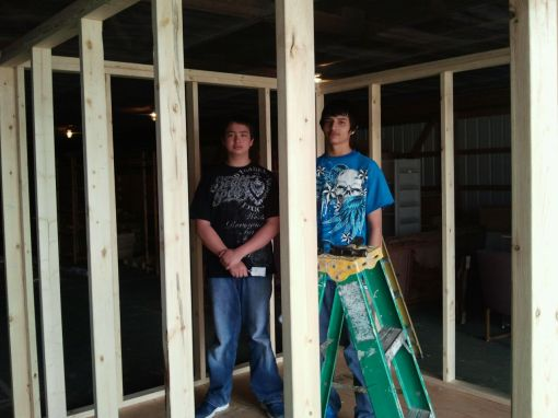 The Lakota children are helping build a shed in service to the community.