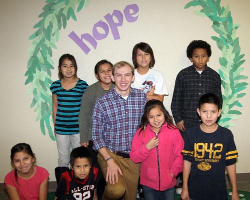 Joe teaches the Native American children Religion at St. Joseph's Indian School.