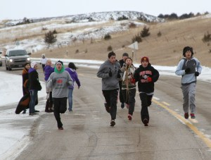 Runners lead the Dakota 38 Memorial riders for the first 10 miles.