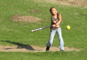 St. Joseph's students learn basic softball skills – hitting, catching and throwing.