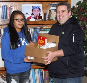 Six Lakota students helped Frank deliver St. Joseph's donation of food to the local domestic violence shelter.