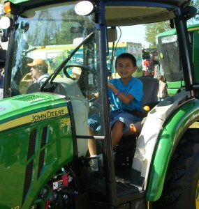 The Lakota boys loved the farm equipment!