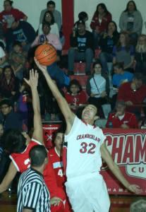 Adrian, a St. Joseph's junior, works hard on the Chamberlain high school basketball team.