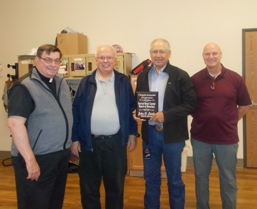Fr. Anthony, Fr. Joe and Mike were present when John received his award for years of service.