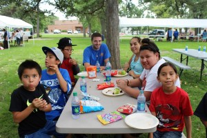 Native American students and family members enjoy a meal during the Back-to-School Picnic at St. Joseph's.