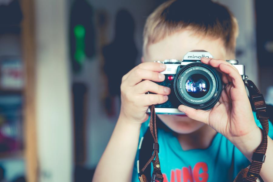 young child taking photo