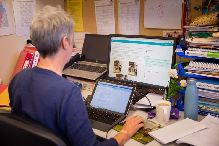 teacher documenting professional growth on computer