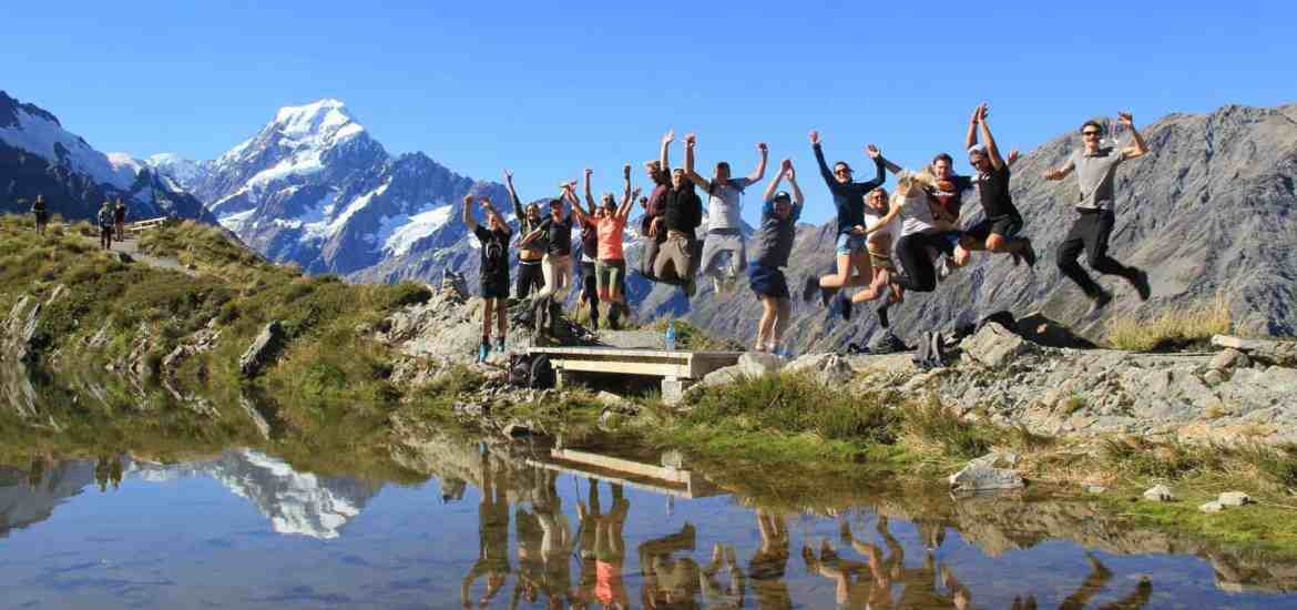Stray New Zealand - pax jumping at Sealy Tarns in Mt Cook National Park