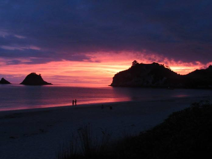 New Years Day sunrise on Hahei Beach - Stray New Zealand