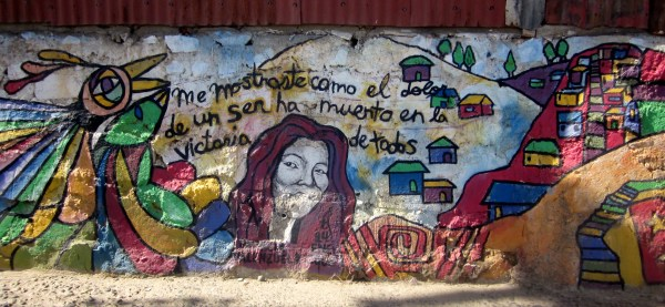 "A beautiful mural on Cerro La Cruz that amazingly survived the flame. It reads ""You showed me how the pain of a human being has died in the victory of everyone"