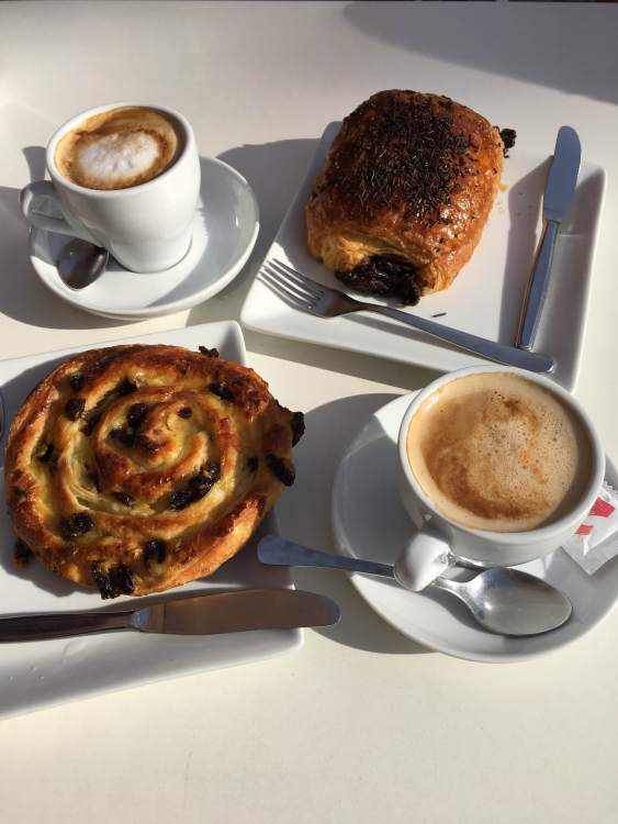 Enjoying coffee and pastries at a cafe in Valencia.