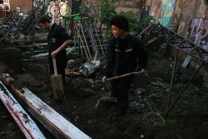 ISA Service-Learning participant Dalton and Benja, Director of Patio Volantín prepare the community garden site. Photo by Lisa Delao.