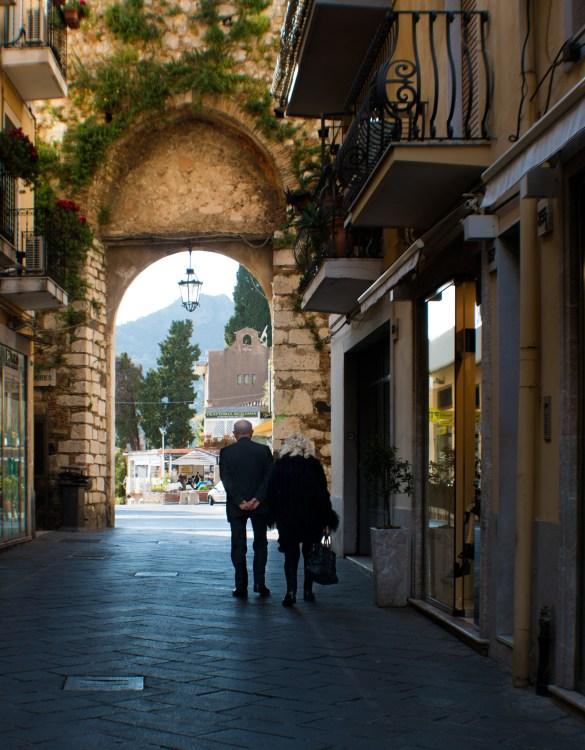 """A couple on their """"passeggiata"""" on Corso Umberto I."""