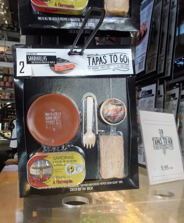 While visiting the market in Madrid, I found this peculiar snack for tourists to enjoy. Tapas to go.