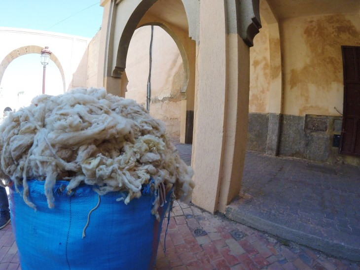 Enormous bags of wool could be found on every street corner as families began preparing their sheep.