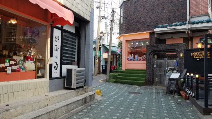 Empty seoul street featuring several shopfronts