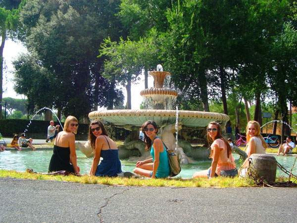 Girls sitting in a fountain in Villa Borghese.