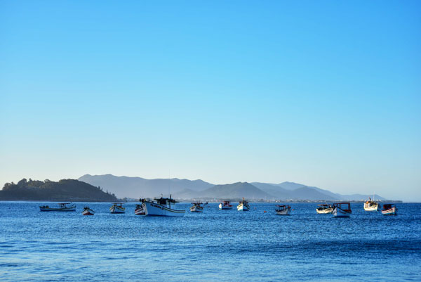 Boats floating offshore of Florianopolis, Brazil