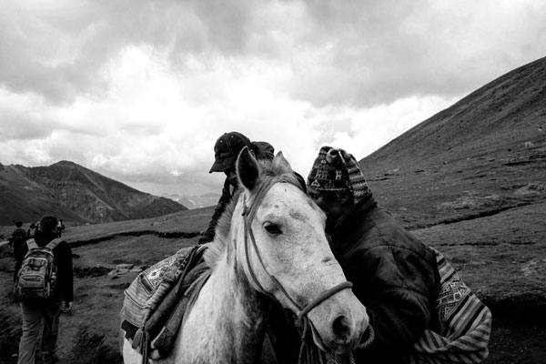 An ISA student horseback riding at Rainbow Mountain in Peru.