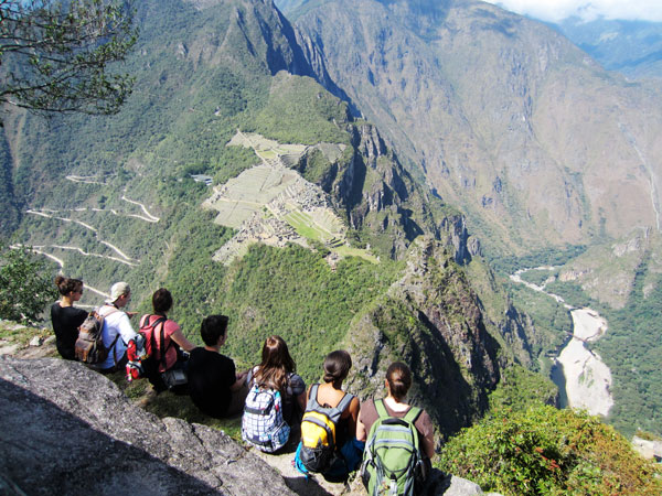 Students looking down at Machu Picchu.