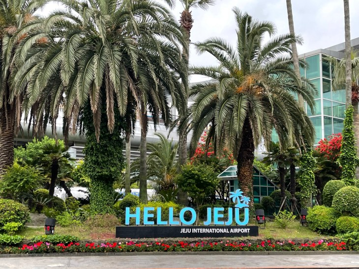 """Sign outside of Jeju International Airport that says """"Hello Jeju"""""""