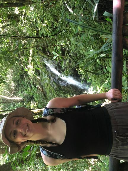 Girl standing in front of waterfall in Manuel Antonio National Park in Costa Rica