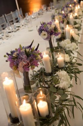 purple flowers decor for a spring wedding