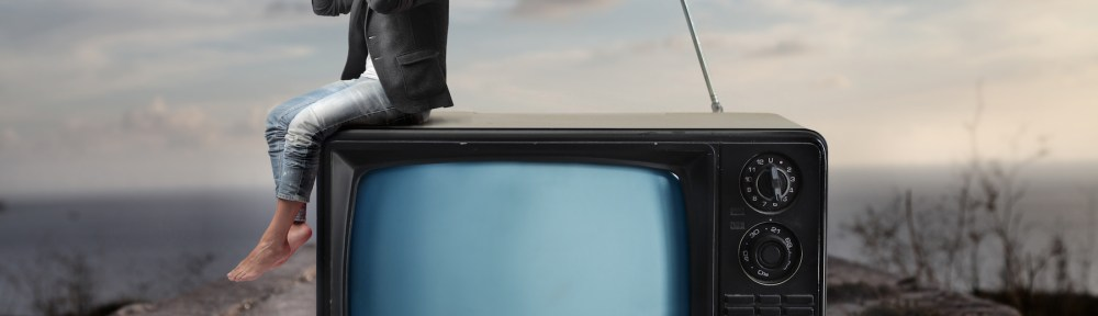 Image of a man on a TV looking for a study abroad program