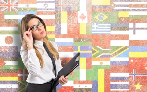 Businesswoman over flags background