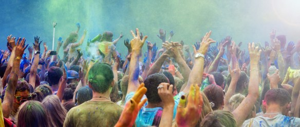 Celebrants dancing during the color Holi Festival