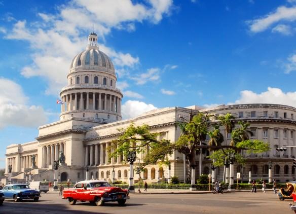 Capitolio building Havana, Cuba with vintage old american cars