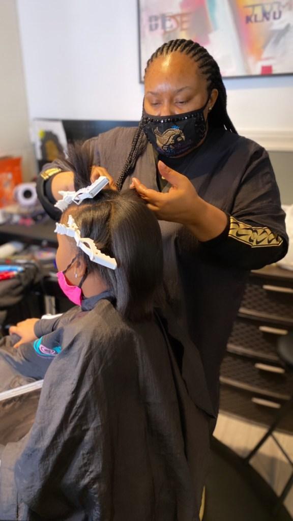 StyleSeat Pro Breyanda Smith styling Client with a silk press