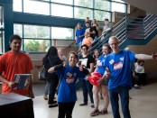 campus connect leaders giving a thumbs up with new students in the background