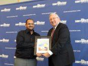 Akram Abdulla receving award from Donald Katt