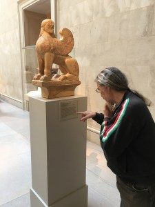 Dino looking at a statue at the Met