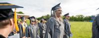 Dino Rende walking at graduation