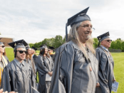 Dino Rende walking at graduation