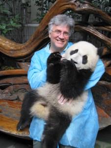 Mark Lewendowski holding a panda cub.