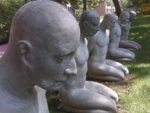 Photo of statues kneeling in park